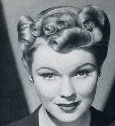 1960s Pin Up Hairstyles Side roll using pin curls